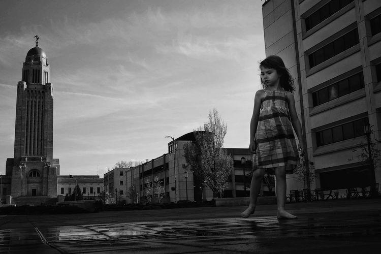 Girl Standing Against Nebraska State Capitol Building