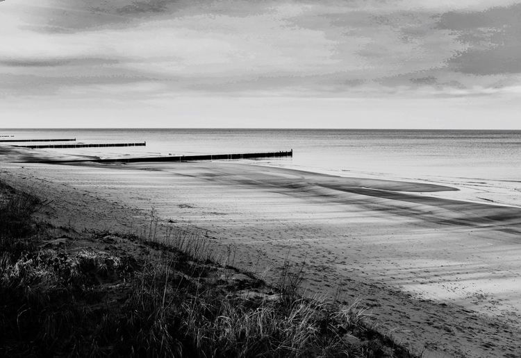 Sea Beach Water Sky Horizon Over Water Tranquility Nature Tranquil Scene Scenics Outdoors Beauty In Nature Cloud - Sky Sand No People Day Grass Nikonphotography The Week On Eyem EyeEm Best Shots Blackandwhite Photography Blackandwhite EyeEm Gallery EyeEm Best Edits EyeEm Selects