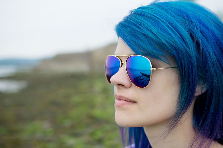 Blue haired woman on the beach Adult Alternative Beautiful Beautiful Woman Close-up Day Fashion Focus On Foreground Headshot Helensburgh Lifestyles Nature One Person Outdoors Park People Real People Reflection Scotland Scottish Sexygirl Stylish Sunglasses Young Adult Young Women