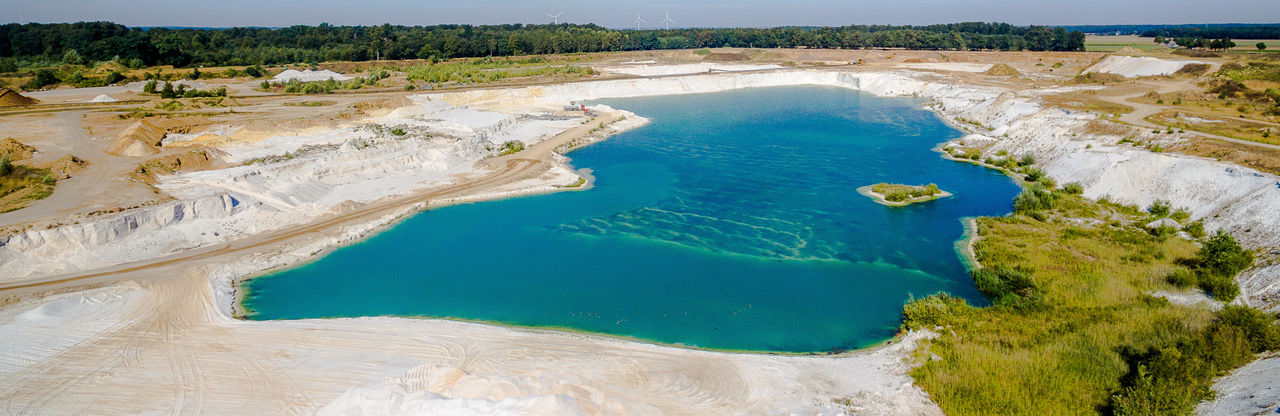 pit for quartz sand filled with water Aerial Shot Drone  Quartz Aerial Aerial View Beach Beauty In Nature Blue Day Drone Photography Droneshot High Angle View Hot Spring Landscape Nature No People Outdoors Sand Scenics Sea Sky Tranquility Travel Destinations Tree Water