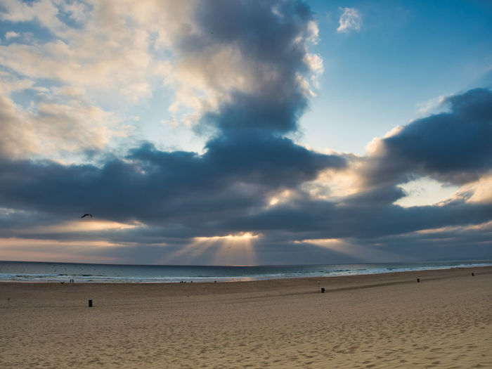 Beach and dramatic clouds in Portugal Sky Cloud - Sky Beach Land Sand Sea Water Scenics - Nature Horizon Over Water Horizon Beauty In Nature Tranquility Nature Tranquil Scene Non-urban Scene Outdoors Day Idyllic
