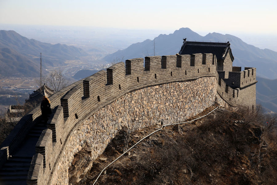 The Great Wall of China near Beijing Ancient Architecture Astronomy Beijing Built Structure Chinese Wall Cultures Day Great Wall Great Wall Of China Great Wall Of China Tower History Horizontal Medieval Mountain Mountain Range No People Outdoors Sky Sunbeam Travel Destinations Wall War Winter