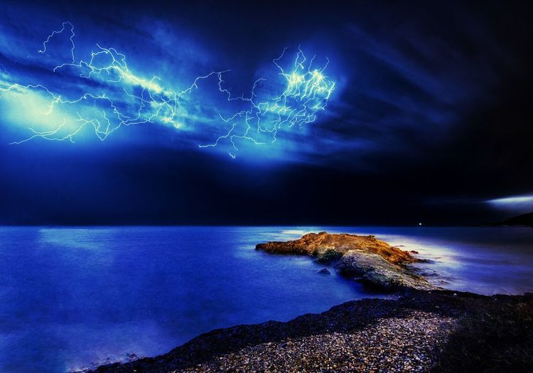 Epitaph of a mariner Thunder Astronomy Lightning Water Galaxy Star - Space Sea Illuminated Beach Blue Arts Culture And Entertainment Thunderstorm Storm Storm Cloud Power In Nature Extreme Weather Maritime Provinces Force