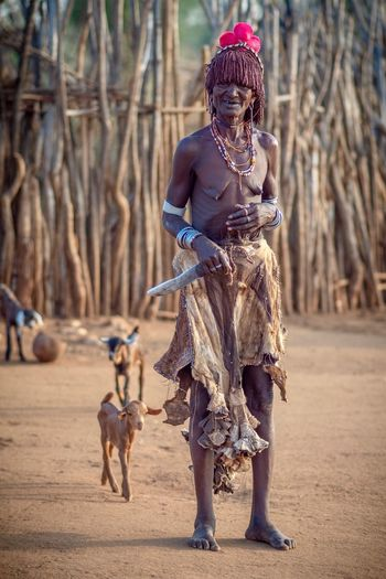 Hamer Tribe - Ethiopia Hamerwoman Hamertribe African Village Portrait Of A Woman Omovalley Omo Valley Travel Destinations Travel Ethiopian Photography 🇪🇹 Portraits African Portrait Photography Ethiopia Portraiture Mammal Domestic Animals Pets One Animal Domestic Dog Canine One Person Full Length Clothing Real People Day Leash Walking Young Adult Outdoors
