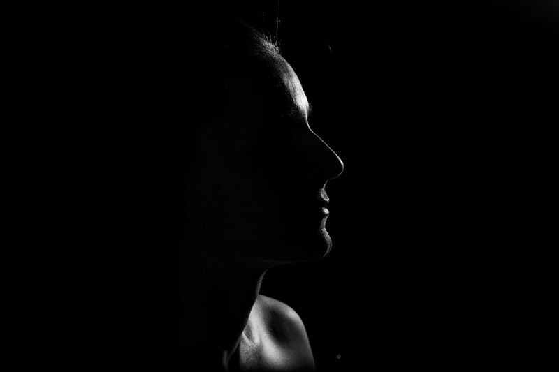 Close-up of woman in darkroom