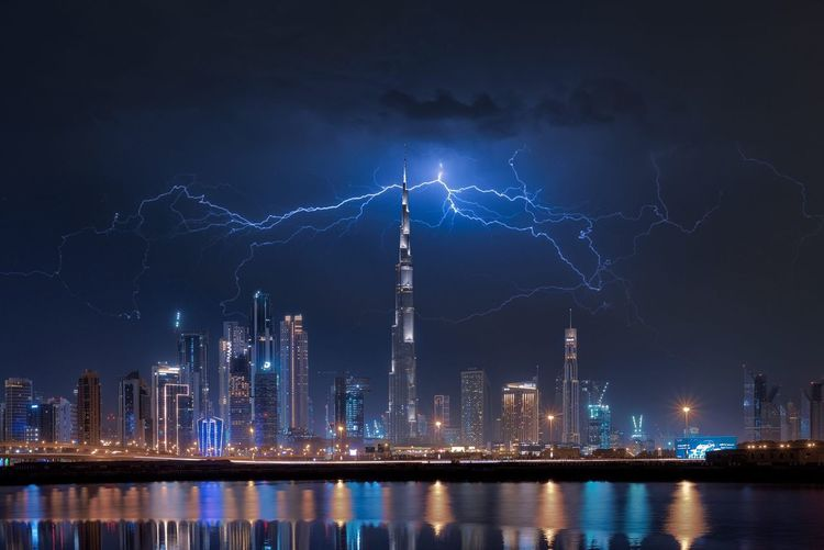 The Lightining and Dubai! Architecture Night Building Exterior Built Structure City Illuminated Building Sky Lightning Water Power In Nature Reflection Office Building Exterior Tall - High Thunderstorm Nature Skyscraper Tower Cloud - Sky No People