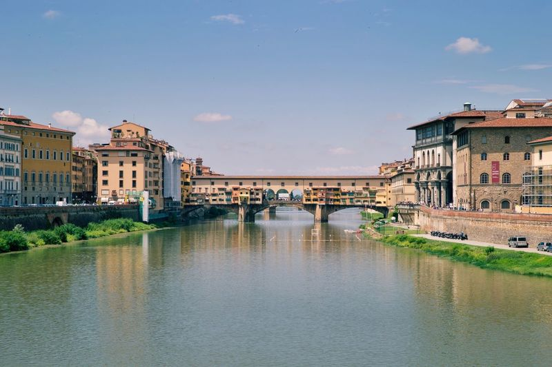 Ponte Vecchio Over Arno River Against Sky