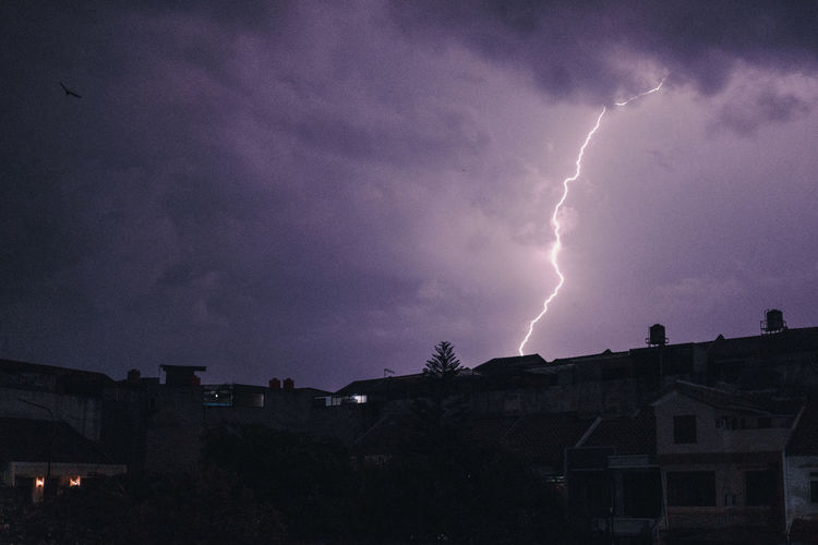 Cloud - Sky Storm Architecture Lightning Power In Nature Building Exterior Built Structure Sky Thunderstorm Power Building Nature Night Storm Cloud Beauty In Nature Sign Warning Sign Forked Lightning Communication No People Outdoors