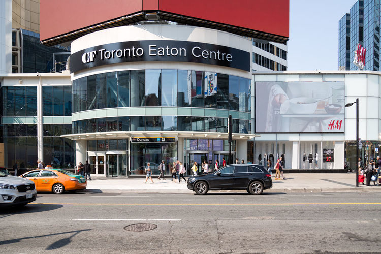 TORONTO, CANADA - SEPTEMBER 04, 2017: A view of the CF Toronto Eaton Center at Dundas Market Shopping Toronto Canada Toronto Eaton Centre Architecture Building Building Exterior Built Structure Business Finance And Industry Car City City Street Communication Day Incidental People Land Vehicle Mode Of Transportation Motor Vehicle Outdoors Road Sign Street Text Transportation Western Script