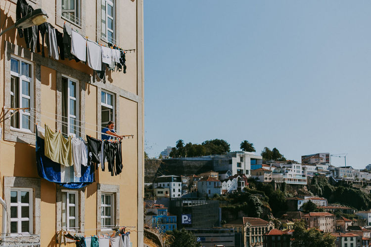 Building Exterior Building City Low Angle View Window Clothing Apartment Sunlight Clothesline Clear Sky Porto Portugal Lifestyles