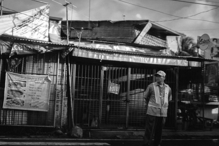 """Decades has gone by but it's still the same."" Black And White Friday Real People Black And White Oldman Street Life Streetphoto_bw Streetview Observing The World Observing People Observing Observing Life ScenesFromTheStreet Scenery Of The Town Scenery_collection Enforcer Traffic Enforcer"