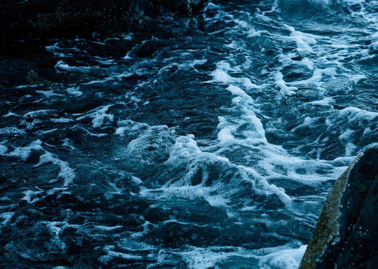 High angle view of waves at sea