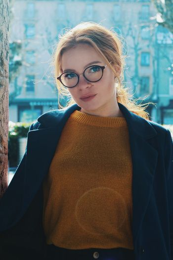 Élodie Eyeglasses  Real People Beautiful Woman One Person Young Women Lifestyles Young Adult Front View Standing Looking At Camera Portrait Glasses Confidence  Architecture Day Smiling Outdoors