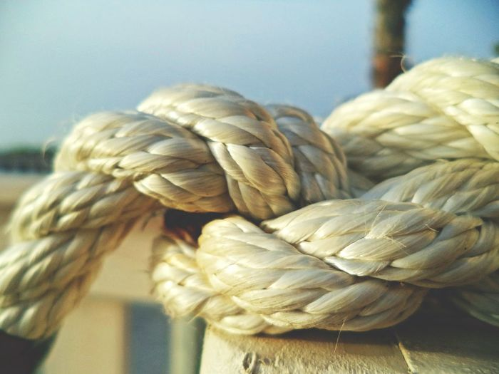 Beach Beachfront Close-up Day Detail Fishing Focus Focus On Foreground Knot Light Macro Naval Naval Theme No People Rope Sailing Seaside Selective Focus Sky Still Life Summer Sunset