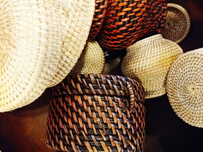High angle view of whicker baskets on table