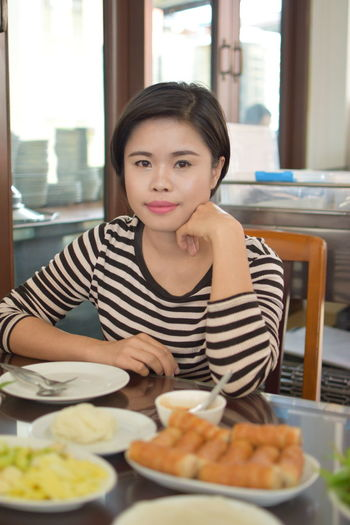 Beautiful Woman Business Casual Clothing Food Food And Drink Front View Hairstyle Indoors  Lifestyles Looking At Camera Meal One Person Plate Portrait Ready-to-eat Real People Restaurant Sitting Table Waist Up Women