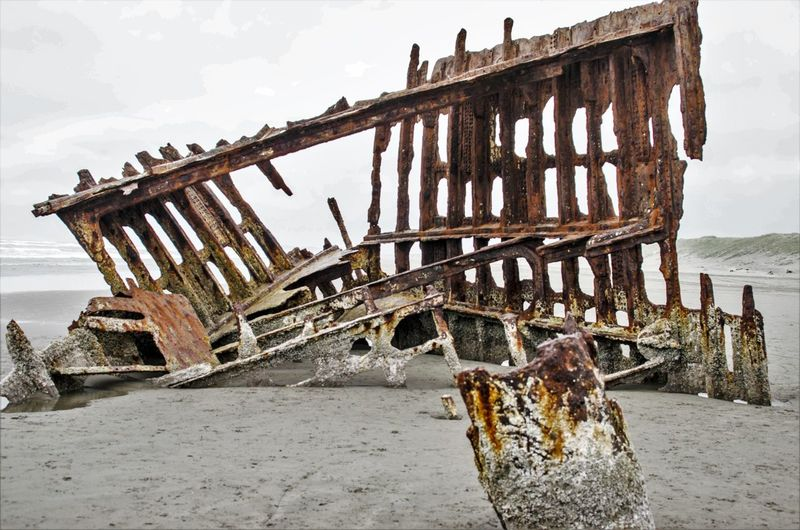Peter Iredale Shipwreck in Warrenton, Oregon Abandoned Architecture Beach Cold Temperature Damaged Day Nature Nautical Vessel No People Outdoors Pier Run-down Rusty Sea Shipwreck Sky Water