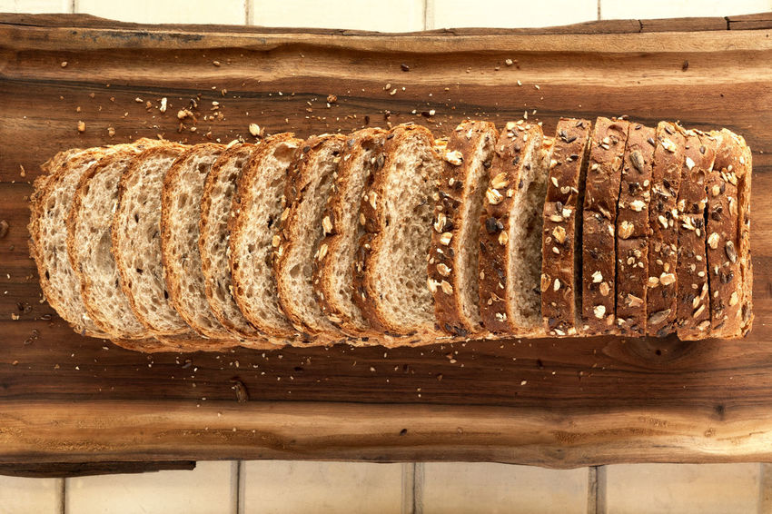 Sliced multigrain bread on cutting board. TopView/ Breakfast Diet Natural Wheat Bake Bakery Bread Brown Bread Close-up Crust Directly Above Food Food And Drink Grain Healthy Eating Loaf Loaf Of Bread Multigrainbread No People Sliced Sliced Bread Studio Photography Wholemeal Bread