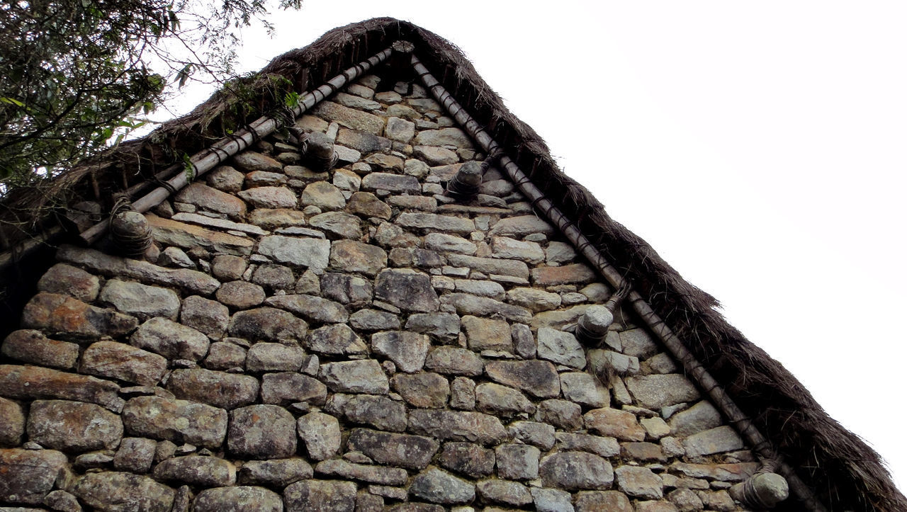 architecture, built structure, stone wall, wall, low angle view, no people, history, the past, nature, sky, building exterior, ancient, stone material, solid, day, building, old, stone - object, outdoors, house, ancient civilization, ruined, roof tile