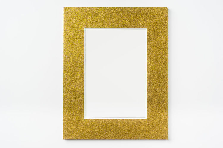 Close-up of yellow art over white background