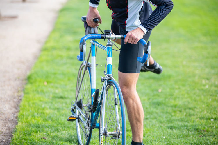 Low section of man riding bicycle