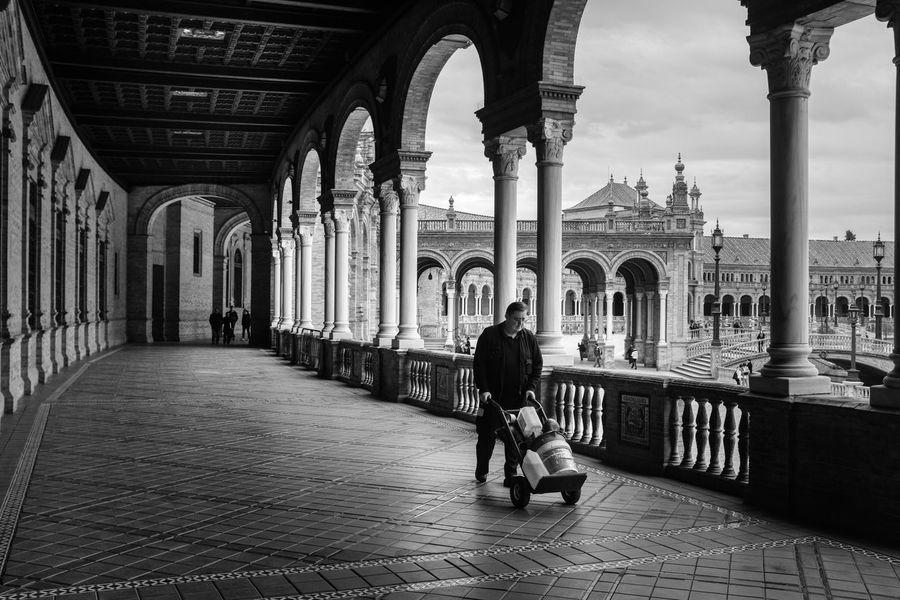 Plaza de España, Sevilla Arch Blackandwhite Architecture Tourism Real People Built Structure Architectural Column Travel Destinations One Person People Building Exterior first eyeem photo