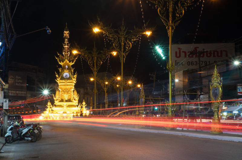 Clocktower in Chiang Rai Illuminated Night Light Trail Motion Architecture Street Long Exposure Road Speed City Building Exterior Transportation Built Structure Blurred Motion Text No People Communication Street Light City Life City Street Light
