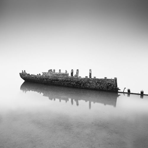 wreck Landscape Fineartphotography Fine Art Minimalism Blackandwhite Photography Blackandwhite Sky Group Of People Water Clear Sky Transportation Nature Day Sea Outdoors Reflection