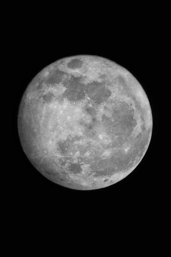 Full moon over black background