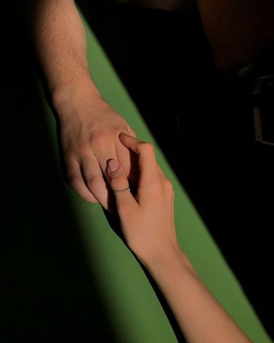 High angle view of couple holding hands