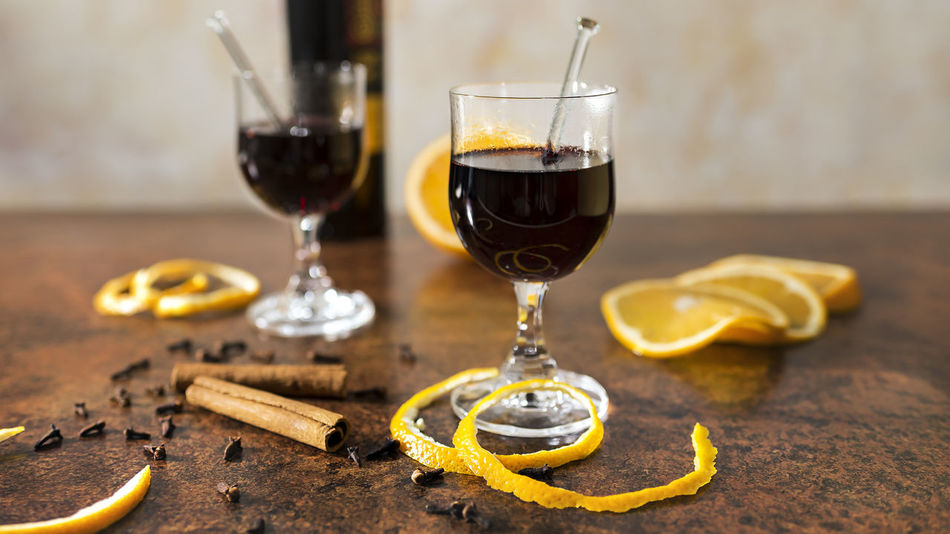 Mulled wine with spices and oranges close up Copy Space Glasses Hot Ingredients Red Wine Rust Studio Vertically Alcohol Cinnamon Cloves Freshly Fruit Home Made Hot Drink Hot Wine Metal Mulled Wine Orange Peel Oranges Season  Short Depth Of Field Spices Warmth Wine
