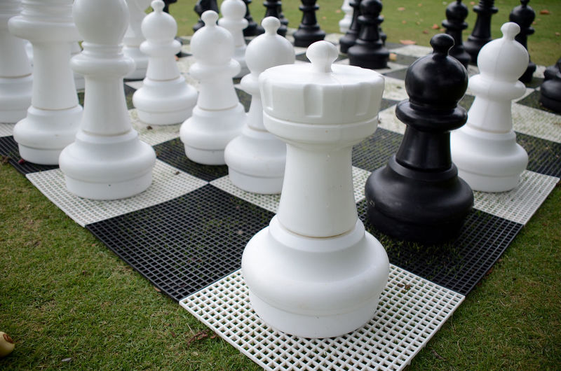 High angle view of chess pieces at park
