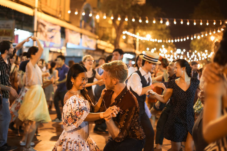 """A ninety-minute drive from Bangkok, Nakhon Pathom hosted the annual """"Big Bang: Swing Dancing"""" organized by the Bangkok Swing group. It was a night of wild, loud and sweaty, with happiness and hundreds of smile from swing dancers and party goers from around the world. And, I like to photograph this happy-vibe event. Capture The Moment Capturing Movement Cultures Dance Dance Party Dancer Dancing EyeEm Best Shots EyeEm Thailand Fun Jitterbug Lifestyles Music Nakhon Pathom Party Q Quality Time Showcase March Swing Dancing Thailand_allshots Things I Like Spotted In Thailand Cities At Night 43 Golden Moments"""