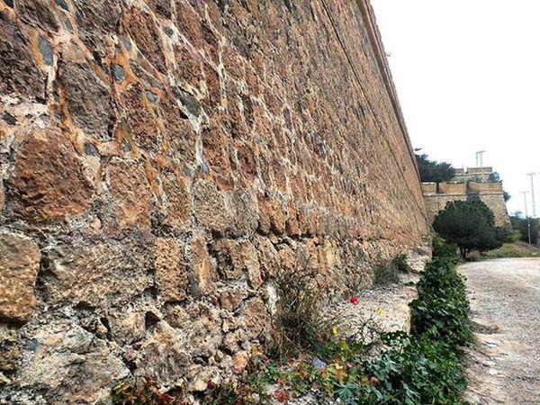 Fort wall and colourful little 💐 Cartagenaspain ColourPhotography España Murcia SPAIN Historicalplace Historicbuilding