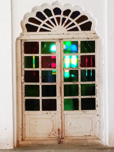 Window Door Old-fashioned No People Colored Windows Whitedoors Olddoordetail Incredible India Hello World Rajasthan World Heritage Worldconnection Multicolor Glass Windowpane Door With Glasses Haunted Haunted Hotel Hanted House Close-up Connected By Travel