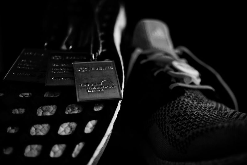 Berlinhalf Berlinhalfmarathon Marathon Real Photography Lifestyle Berlin Shoes Sport Sports Photography Sport In The City Monochrome Blackandwhite Medaille 35 Mm No People Still Life Real Life Running Beauty In Ordinary Things