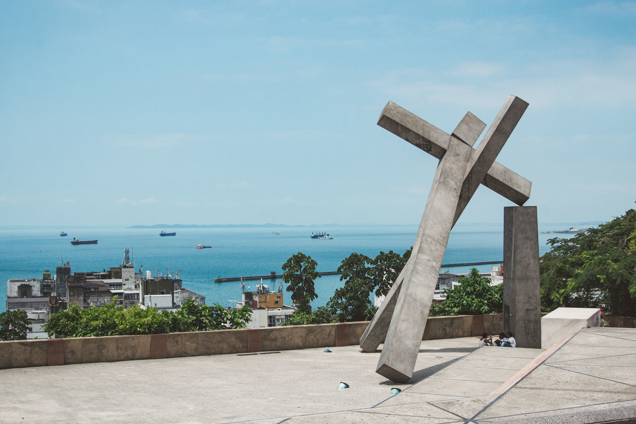 sea, sky, day, cross, religion, horizon over water, no people, outdoors, water, scenics, nature, beauty in nature, architecture