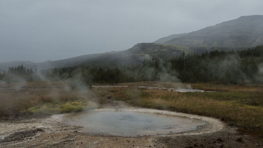 Iceland Strokkur Strokkur Geysir Beauty In Nature Day Environment Geology Geyser Heat - Temperature Hot Spring Land Landscape Mountain Nature No People Non-urban Scene Outdoors Physical Geography Pollution Power In Nature Scenics - Nature Sky Steam Water