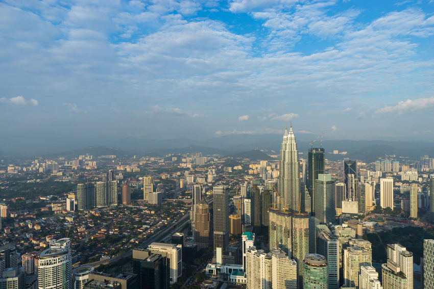 KUALA LUMPUR, MALAYSIA - 20TH DEC 2017; View of downtown Kuala Lumpur from Kuala Lumpur Tower, a highest telecommunication tower in Malaysia (421 metres) and was completed on 1 March 1995. Business Cityscape Construction Economy Financial District  KLCC Twin Towers Kuala Lumpur Skyline Tourist Attraction  Aerial View Building Clouds And Sky Concrete Jungle Malaysia Outdoor Panoromic Petronas Twin Towers Pollution Skylines Skyscraper Structure Sunset Travel Destinations Unfinished Urban