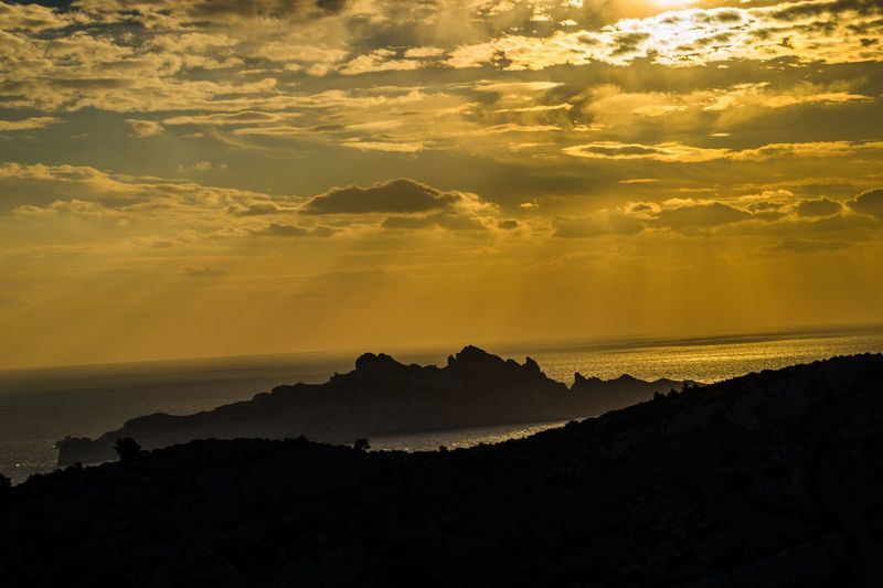 marseille,calanque,bouche du rhone, france Sky Cloud - Sky Sunset Scenics - Nature Beauty In Nature Tranquility Tranquil Scene Mountain Silhouette Nature Environment No People Non-urban Scene Idyllic Landscape Orange Color Land Outdoors Rock Dramatic Sky