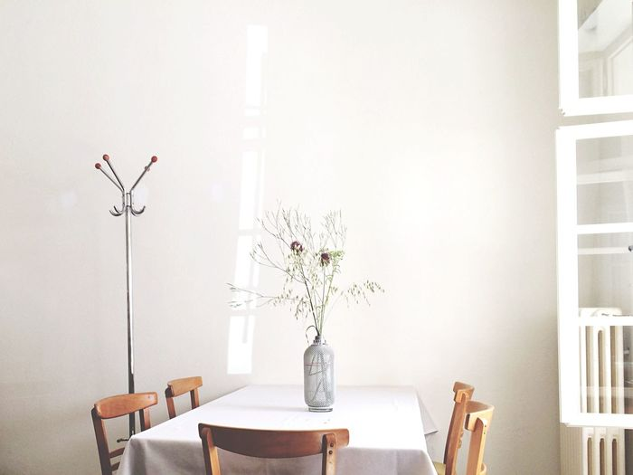 Vase on dining table at home
