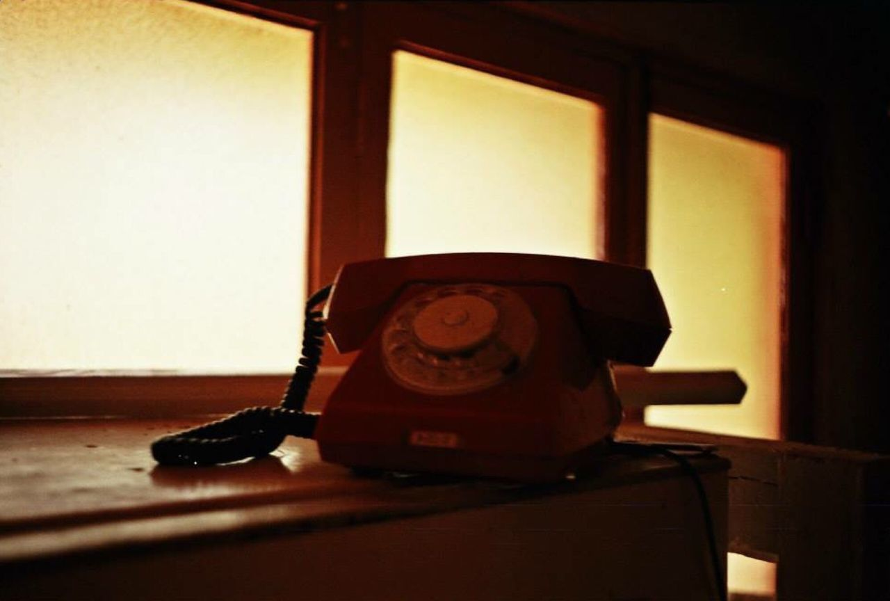old-fashioned, indoors, retro styled, telephone, landline phone, table, technology, no people, wood - material, antique, telephone receiver, rotary phone, close-up, day