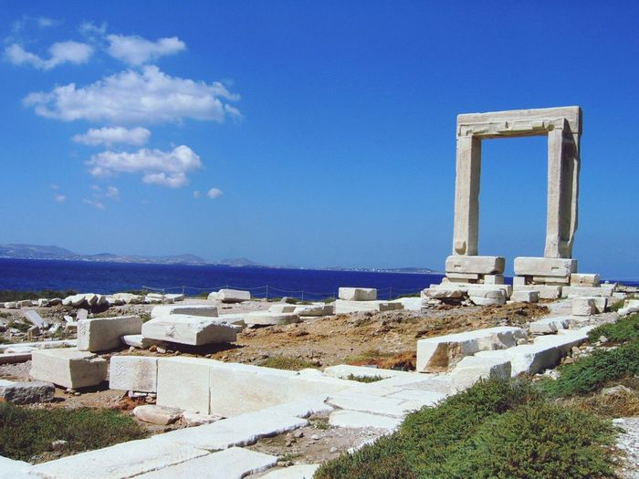 By the sea Architecture Built Structure Blue History Sky No People Outdoors Nature Travel Destinations Sea Ancient Civilization Greece Naxos, Greece Gate Clouds And Sky Travel Photography Tadaa Community EyeEm Best Shots Aegean Sea Aegean Islands
