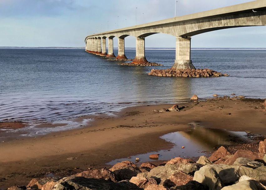 Confederation Bridge from the New Brunswick side. New Brunswick, Canada Confederation Bridge Piling Sea Northumberland Straight Built Structure Connection Water Transportation Architecture Bridge - Man Made Structure Beach Rocks