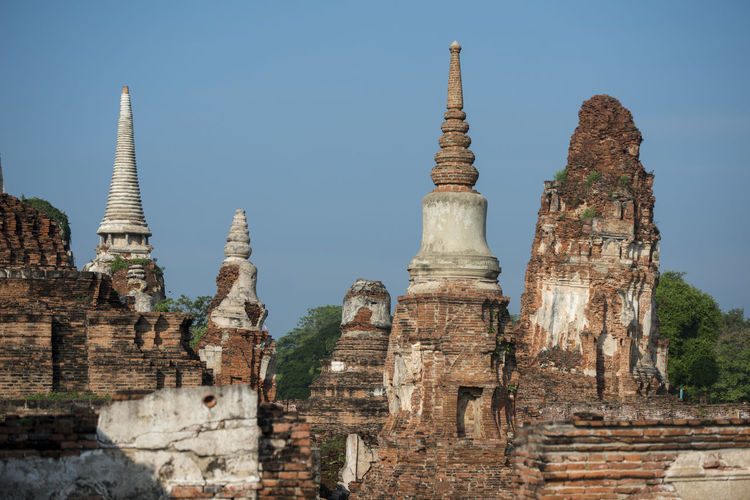 Low Angle View Of Old Built Structures At Wat Mahathat