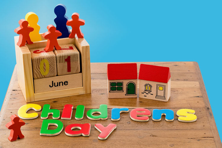 Toys and children day text over blue background