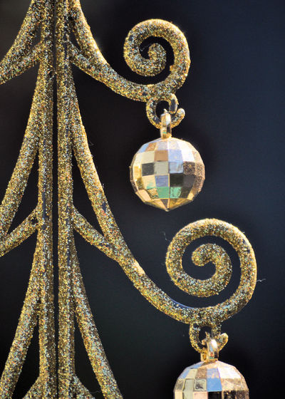 Close-up of christmas decoration hanging against black background
