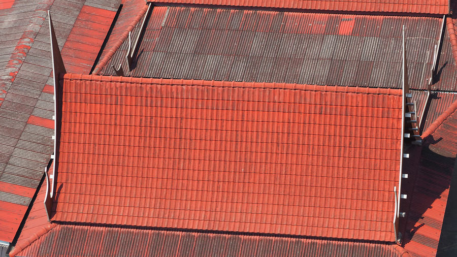 Roof tiles and made from ceramic and metal material and top view angle. Architecture Ceramic High Angle View House Old Roof Roof; Old; Tiles; Tile; Roofing; House; Red; Architecture; Structure; Texture; Broken; Building; Pattern; Color; Row; Shingle; Traditional; Construction; Exterior; Shingles; Brown; Design; Material; Blue; Green; Yellow; Brick; White; Grey; Rooftop; Home;  Rooftop Tiles