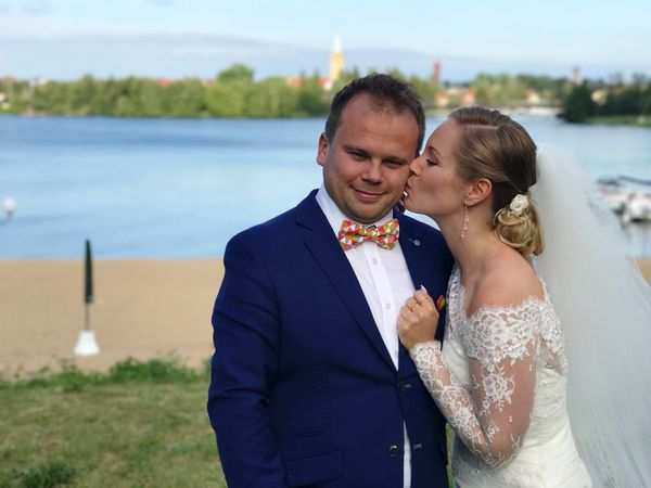 EyeEm Selects Wedding pair during photo session Wedding Love Togetherness Bridegroom Bride Celebration Life Events Wedding Ceremony Husband Happiness Bow Tie Groom Ceremony Wedding Dress Married Well-dressed