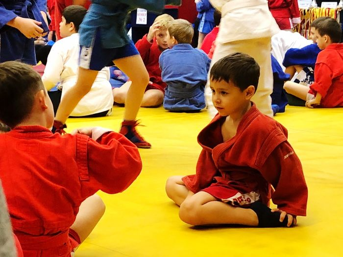 Fight Children Sport Wrestling Fight Sambo Child Childhood Boys Group Of People Real People Males  Sitting Togetherness People Leisure Activity Lifestyles Sport Crowd